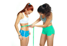 Women measuring waist with a tape Stock Photography