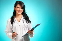 Women medicine doctor with pen and notepad royalty free stock images