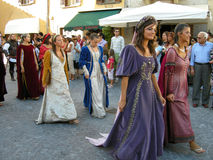 Women in medieval times costumes. Two women in medieval costumes walking in the streets celebrating the medieval festival SERATA MEDIEVALE, Cantiano, Italy, 17 Stock Images