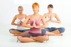 Women meditating stock photography