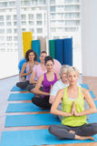 Women meditating in fitness class Stock Images