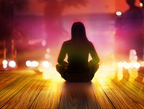 Women are meditating at night and rays of light  in the city Royalty Free Stock Image