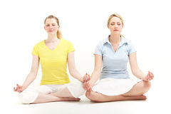 Women meditating together Royalty Free Stock Photos