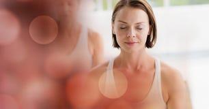Women meditating in yoga studio. Digital composite of Women meditating in yoga studio Royalty Free Stock Image