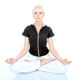 Women in meditation. Beautiful young blondy make a meditation stock photos