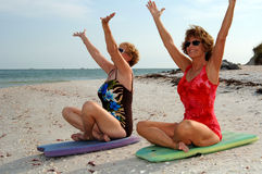Women meditation on beach Royalty Free Stock Image
