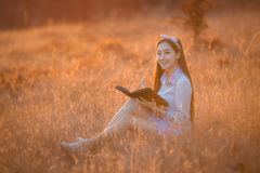 Women are memoirs on a note close at sunset. Royalty Free Stock Photography