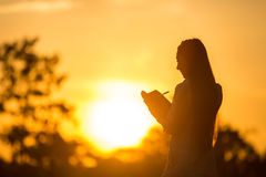 Women are memoirs on a note close at sunset. Stock Photos