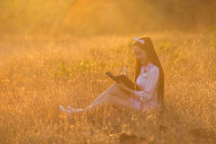 Women are memoirs on a note close at sunset, nostalgia. Women are memoirs on a note close at sunset, nostalgia Stock Image