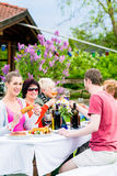 Women and men celebrating garden party Royalty Free Stock Images