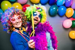 Women and men celebrating at party for new years eve or carnival stock photo