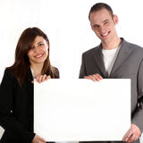 Women and men keep laughing unmarked, white sign. Stock Photos
