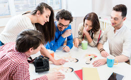 Women and men in office of creative agency Stock Photos