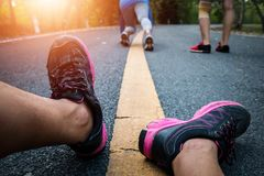 Women and men runner feet on road in workout wellness. Women and men runner feet on road in workout wellness concept Royalty Free Stock Photography