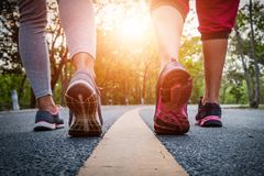 Women and men runner feet on road in workout wellness. Women and men runner feet on road in workout wellness concept Stock Image