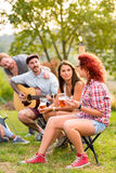 Women and men socializing. In nature Stock Image