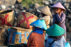 Women and men standing and waiting for the fishing boats Royalty Free Stock Image