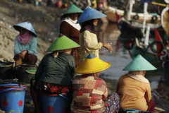 Women and men standing and waiting for the fishing boats Royalty Free Stock Images