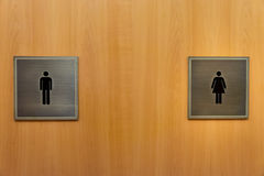 Women and Men Toilet Sign Stock Photos
