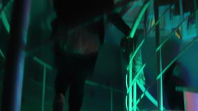 Women and men walking up and down the stairway. Night club atmosphere. Weekend. Stock footage stock footage