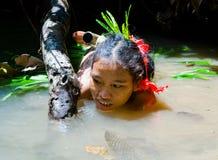 Women Mentawai tribe fishing. stock images