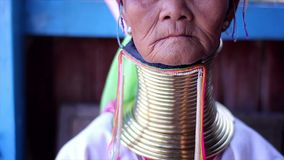 Women with metal rings on the neck. Myanmar, Inle Lake. 18.11.2013  Women with metal rings on the neck. The ancient culture of Myanmar. Long-necked women. Tribe stock footage
