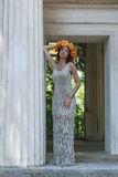 Women model with wreath. Girl in white dress in rome Stock Image