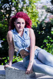 Women model hair red. Girl with red hair in the wind Royalty Free Stock Photography