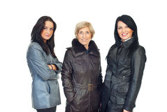 Women models in leather jackets. Three beautiful women different ages wearing leather jackets and standing in a line isolated on white background Stock Photos