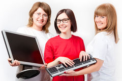 Women with a monitor and keyboard Stock Image