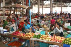 Business women are active with selling tropical fruits at the indoor market, Vientiane, Laos. Women are selling fruits at the indoor morning market in Vientiane Royalty Free Stock Image
