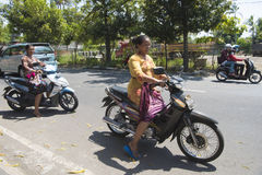 Women on motorbike, Bali royalty free stock photos