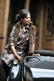 Women by motorcycle Royalty Free Stock Photography