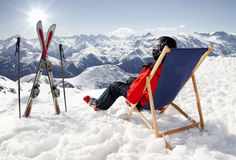 Women at mountains in winter lies on sun-lounger Stock Images