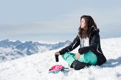 Women at mountains in winter sits on snow Stock Photo