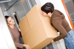Women moving home Stock Photos