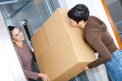 Women moving home Stock Images