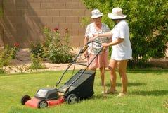 Women Mowing lawn Royalty Free Stock Image