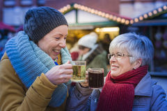 Women with mulled wine Stock Images