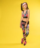 Women with muscular body in colourful clothes royalty free stock images