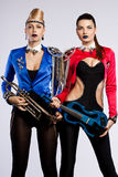Women with musical instruments Royalty Free Stock Photo