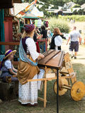 A women musician dressed in mediaeval dress plays a hammered du. The Minnesota Renaissance Festival is a Renaissance fair, an interactive outdoor event which Royalty Free Stock Image