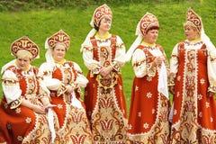 Women in national Rusccian dresses stock photos