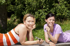 Women in nature with e-cigarettes Stock Photography