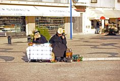 Women of Nazare. Nazare, Portugal - November 27, 2013 : Old women are selling goods to visitors of the fishing village Nazare Stock Photo