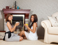 Women near the fireplace Royalty Free Stock Photography