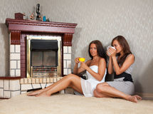 Women near the fireplace Stock Image