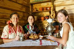 Women near   russian samovar Royalty Free Stock Photos