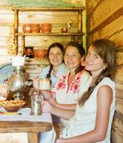 Women near  traditional  samovar Royalty Free Stock Images