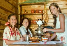 Women near  traditional  samovar Stock Photography
